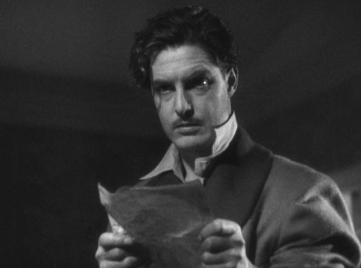 Robert Donat stars as Richard Hannay holds a piece of paper in The 39 Steps