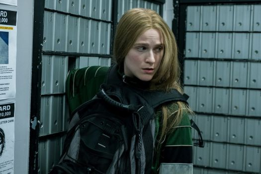 Evan Rachel Wood puts her entire arm into a post-office box in Miranda July's Kajillionaire