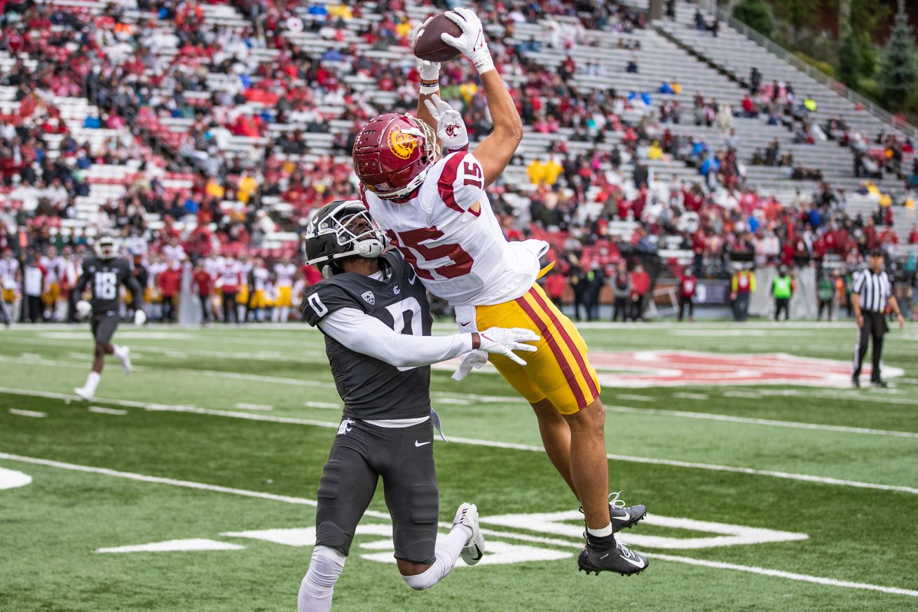 PULLMAN, WA - SEPTEMBER 18: USC receiver Drake London (15) catches a pass over cornerback Jaylen Watson (0) in the second half of a PAC 12 conference matchup between the USC Trojans and the Washington State Cougars on September 18, 2021, at Martin Stadium in Pullman, WA.