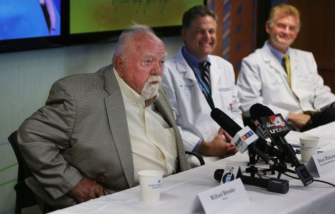 Wilford Brimley, left, talks during a press conference at Intermountain Medical Center in Murray on Monday, May 16, 2016, about receiving a WATCHMAN left atrial appendage closure device as Dr. Pete Weiss and Dr. Brian Whisenant look on. Brimley died on Aug. 1 at the age of 85.