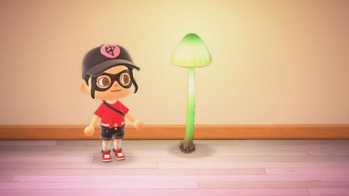 An Animal Crossing character stands next to a green glowing mushroom lamp