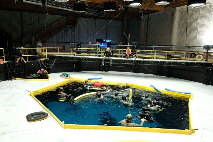 actors in a water tank for avatar 2 with james cameron barking orders overhead
