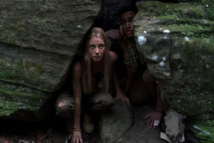 Charlotte Vega and Adain Bradley in Mike P. Nelson's Wrong Turn reboot.