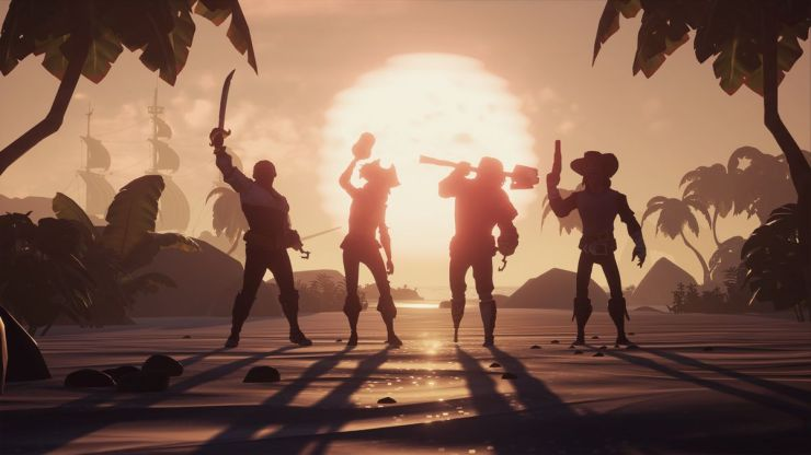 A sea of thieves - four players and a sunset behind them