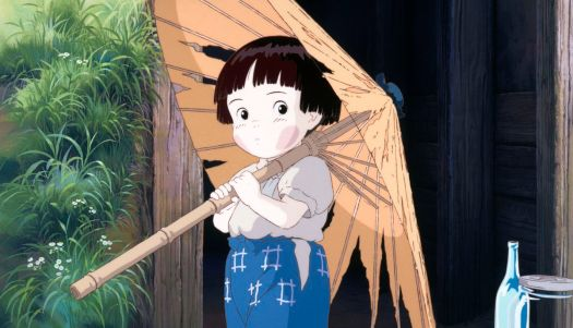 A grubby child stands outside under a torn paper umbrella in Grave of the Fireflies