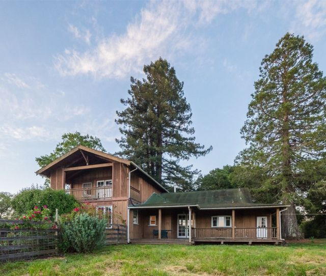 The S Farmhouse Sits On A Two Parcel Property Measuring About  Acres Photos Via Sothebys International Realty
