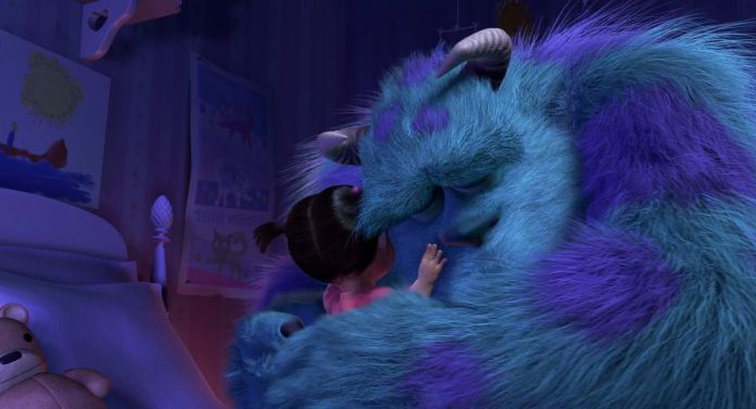 fluffy blue monster Sully embraces small child Boo