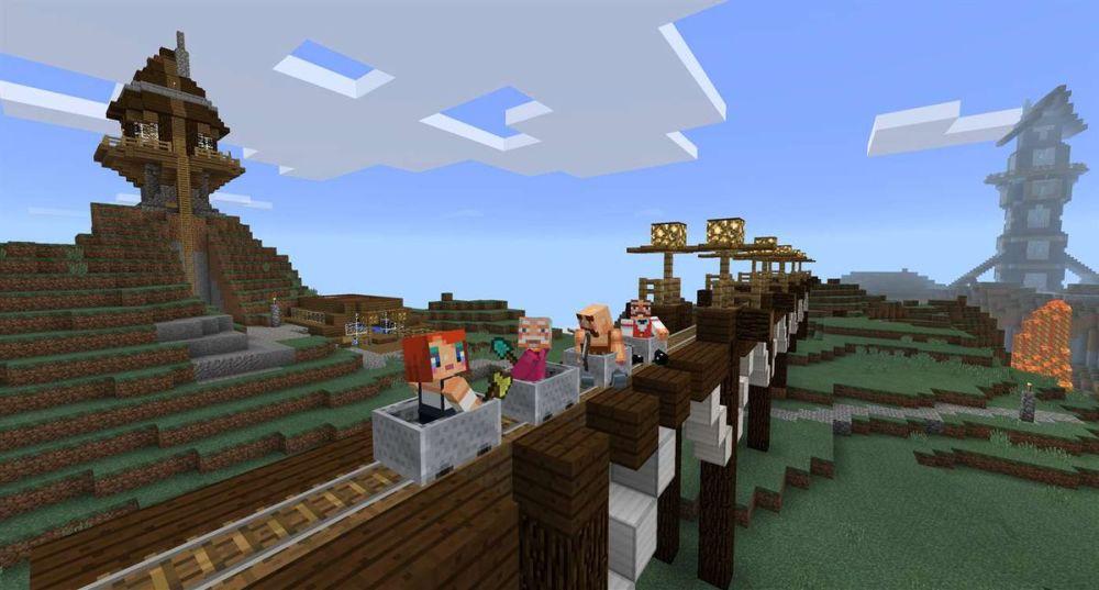Minecraft - quatre personnages dans un chariot de mine
