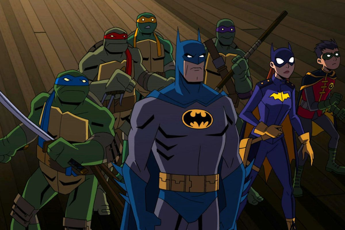 The 4 ninja turtles stand with Batman, Batgirl and Robin