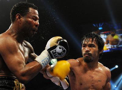 Manny Pacquiao of the Philippines (R) la