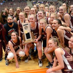 The Morgan High School girls' basketball team celebrate their state championship on Saturday, February 27, 2021 in Richfield.