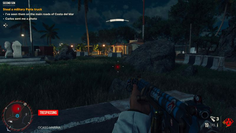 Enemies fighting on a base at night in Far Cry 6