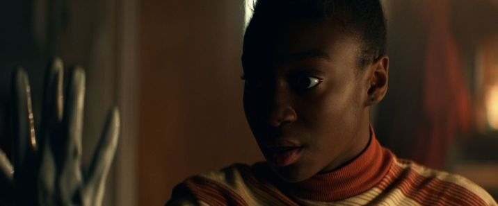 Shahadi Wright Joseph looks with shock at a withered grey hand in Amazon Studios' Them