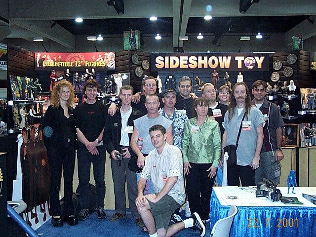 Richard Taylor and Ringer fans in front of the Sideshow Toys booth at San Diego Comic-Con 2001.