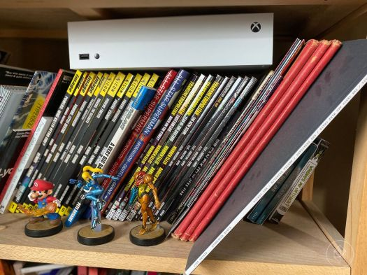Photo of Xbox-S console on top of books