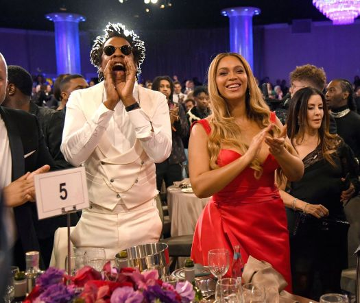 Beyonce and Jay-Z standing at a charity gala.