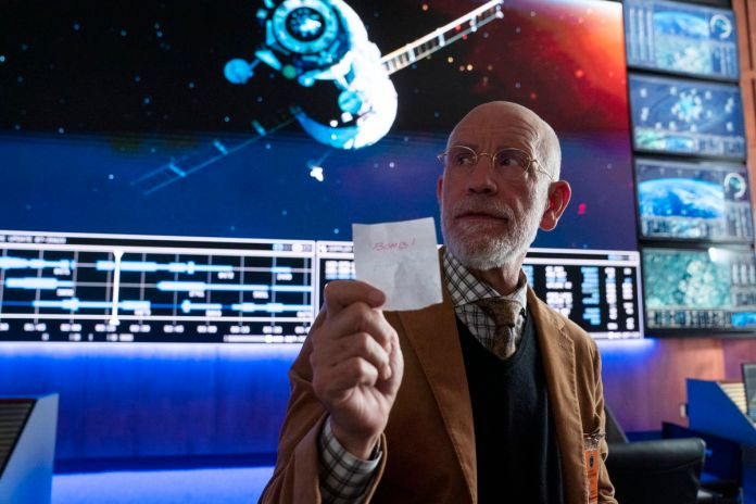 Dr. Mallory (John Malkovitch) holds a document that says