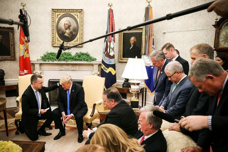 President Trump and American evangelical Christian preacher Andrew Brunson (left) pray together in the Oval Office, a day after Brunson was released from a Turkish jail, on October 13, 2018.