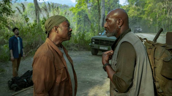 two black men confront each other in Da 5 Bloods
