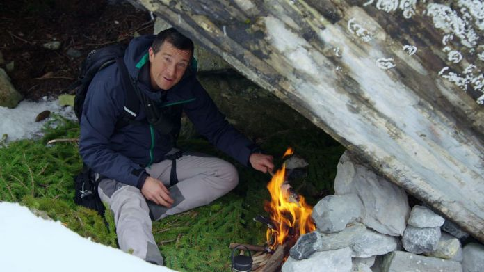 bear grylls and a fire