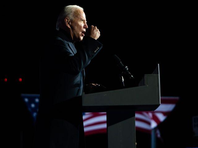 Joe Biden speaking from a podium.