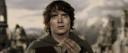 a weathered Frodo holding the ring and looking upward in The Lord of the Rings: The Two Towers