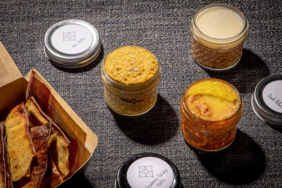 A series of jars filled with various dips and sauces