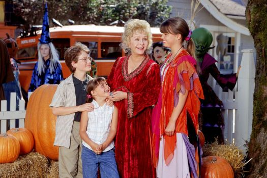 the piper family gathers during halloween and smiles