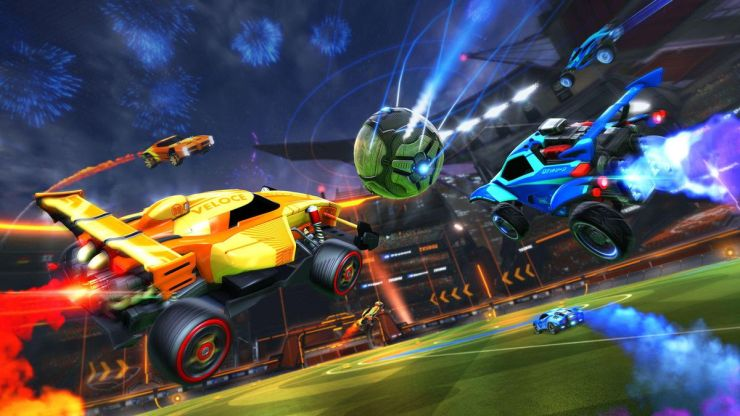 Rocket League - Yellow, blue and orange cars attacking the ball
