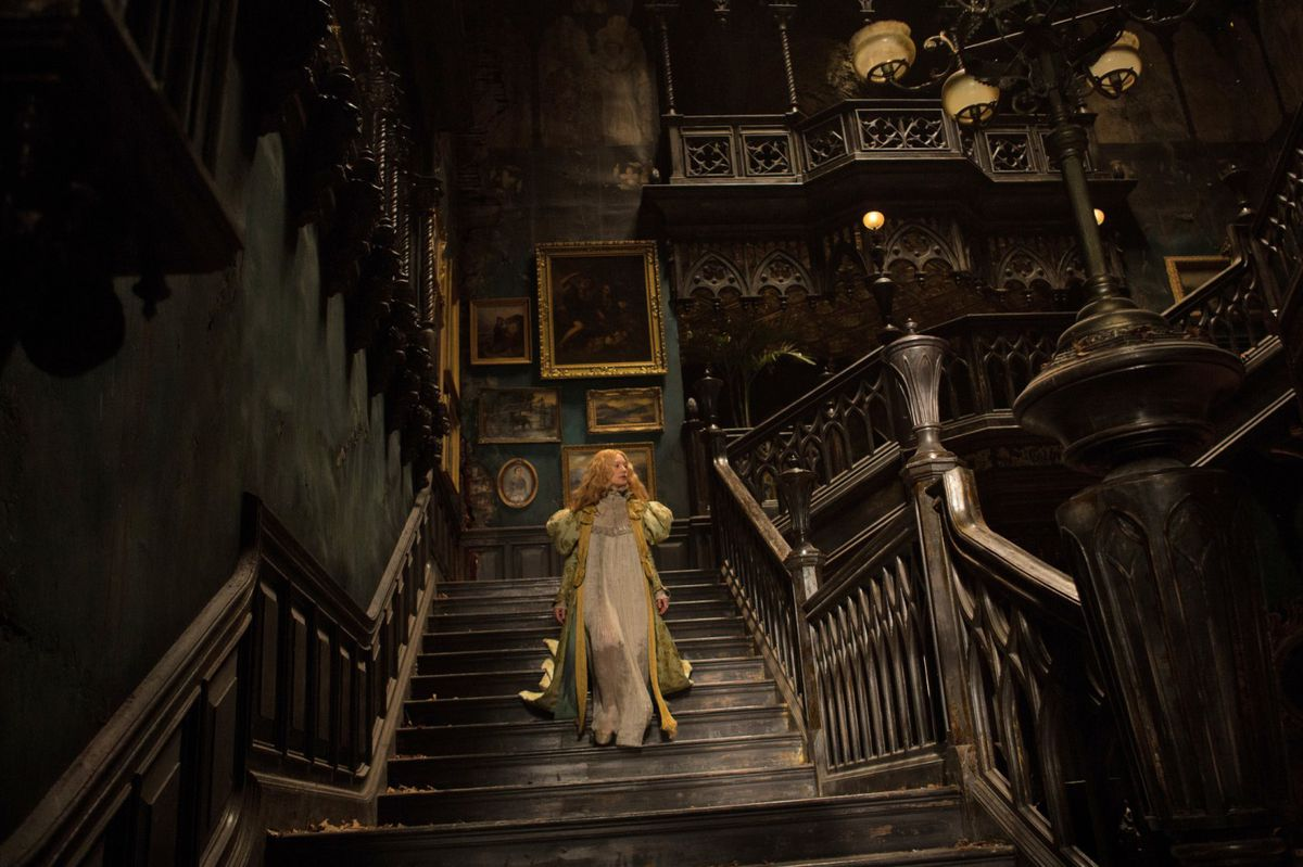 a lone figure in white walking down the staircase of a dilapidated mansion