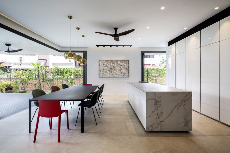 Kitchen opening onto concrete terrace.