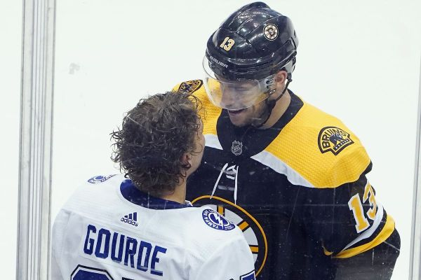 Yanni Gourde of the Tampa Bay Lightning exchanges words with Charlie Coyle of the Boston Bruins during the third period in an Eastern Conference Round Robin game during the 2020 NHL Stanley Cup Playoff at Scotiabank Arena on August 5, 2020 in Toronto, Ontario, Canada.