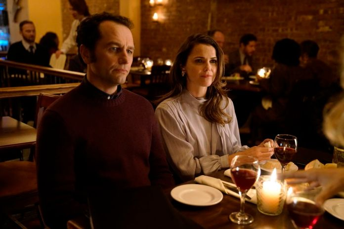 Matthew Rhys as Phillip and Keri Russell as Elizabeth sitting down for a nice meal with some friends
