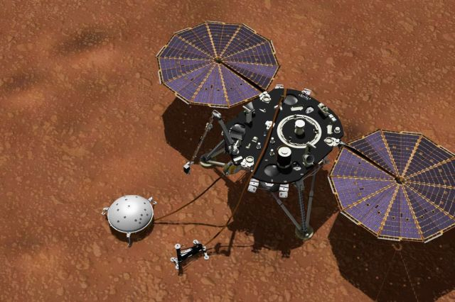 A lander sits on the orangish surface of Mars.