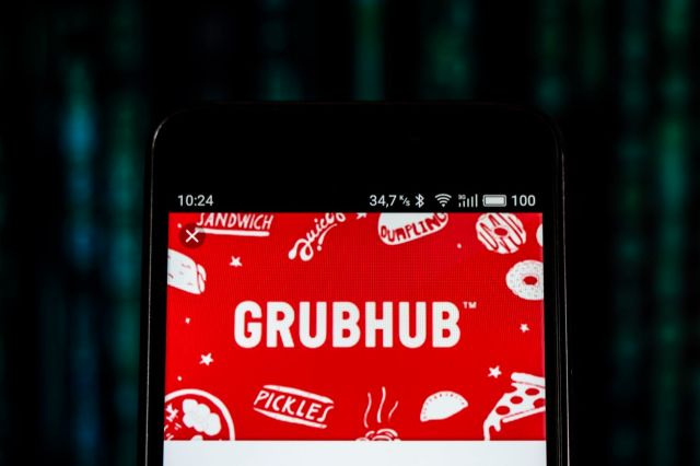 GrubHub logo seen displayed on smart phone. Grubhub Inc. is