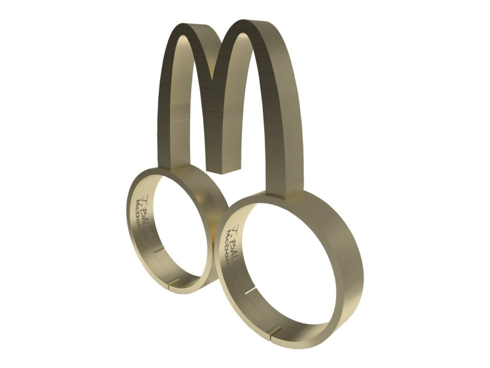 A metal two-finger ring with a McDonald's M arching off the top