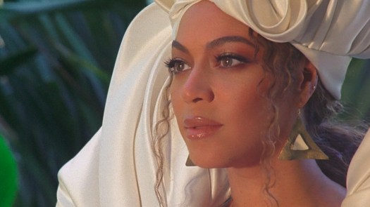 Beyonce in white headdress and gown in Black Is King