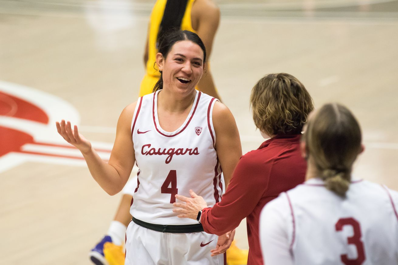 PULLMAN, WA - FEBRUARY 28: Washington State guard Krystal Leger-Walker (4) talks to her coach after a win in a Boeing Apple Cup Series matchup between the Washington Huskies and the Washington State Cougars on February 28, 2021, at Beasley Coliseum in Pullman, WA.
