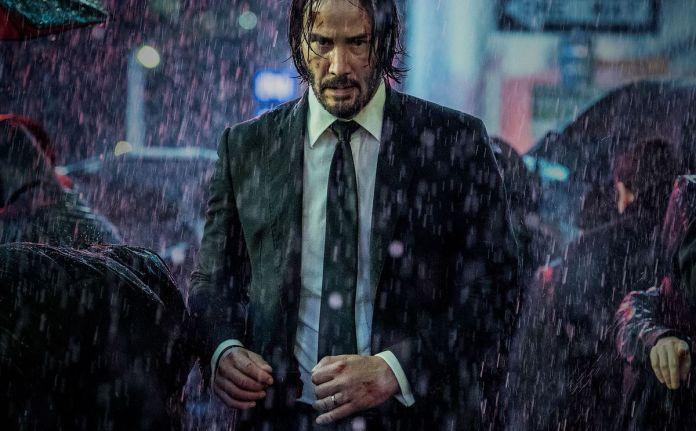 John Wick walks in the rain in a still from John Wick: Chapter 3— Parabellum
