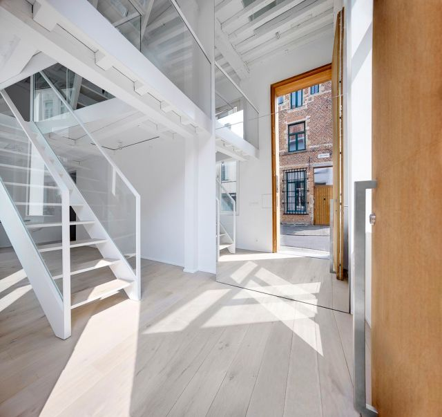 Entrance of narrow home with light pattern on floor