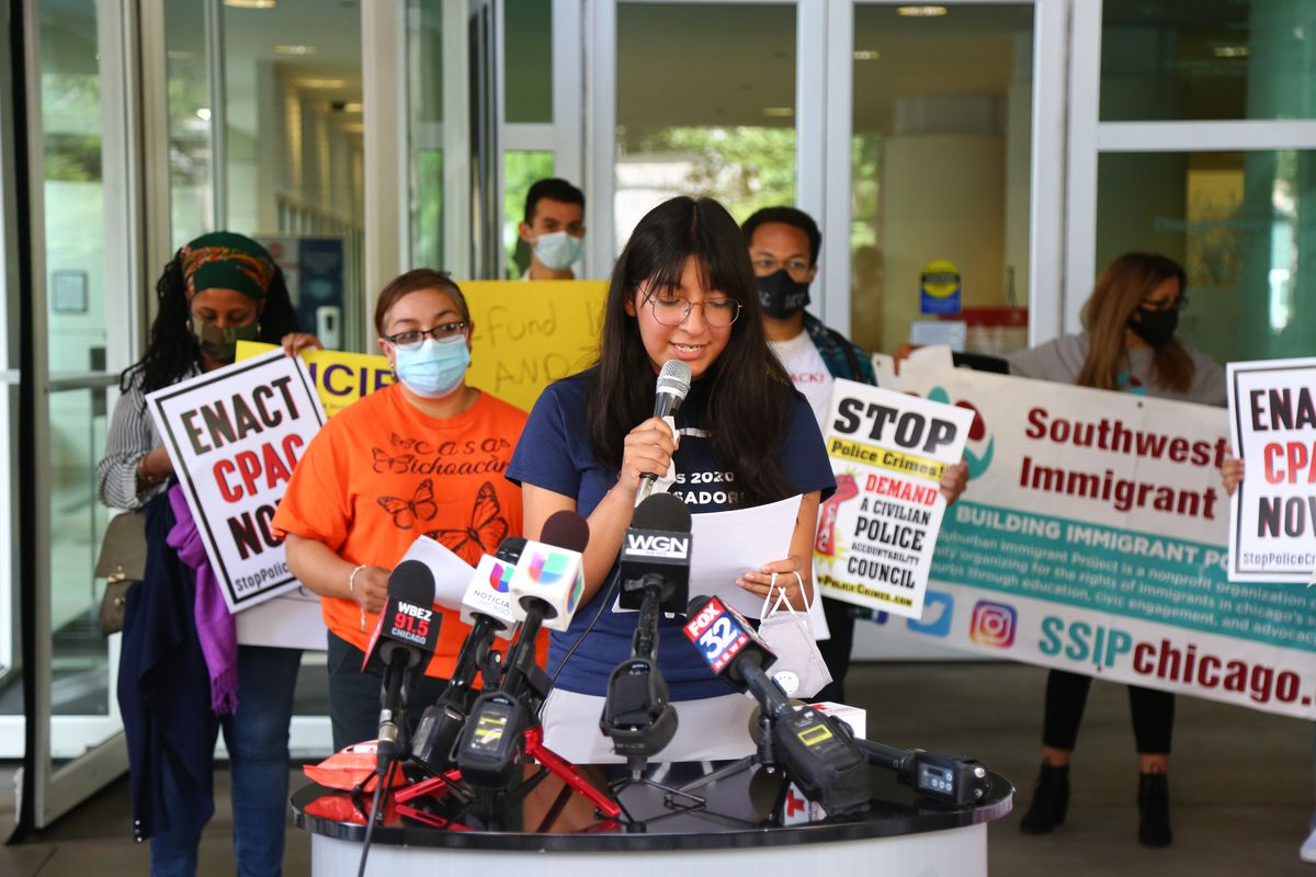 Sandra Diaz, Mano a Mano, speaks with the media during a protest outside the Immigration and Customs Enforcement office at 101 W. Ida B. Wells Dr. in the South Loop, Tuesday, Aug. 4, 2020.