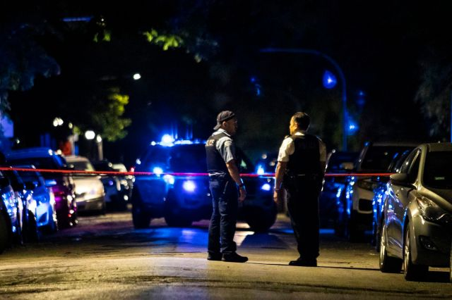 Chicago police investigate early Saturday in the 1400 block of South Tripp Avenue, where five people were shot and wounded in a mass shooting in Lawndale on the Southwest Side.