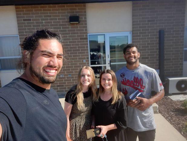 Green Bay teammates Bronson Kaufusi and Christian Uphoff meet with Latter-day Saint missionaries. Courtesy of Bonson Kaufusi via Desert News.