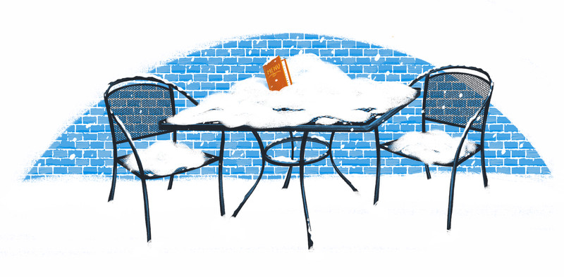 An illustration of a cafe table buried in snow.
