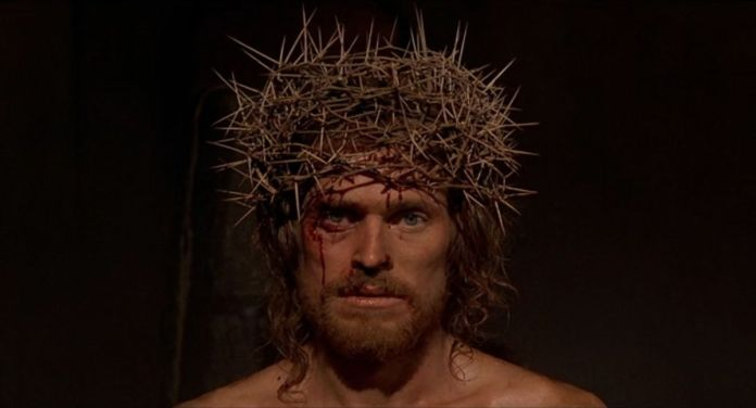 A close-up of Willem Dafoe as Jesus in The Last Temptation of Christ, wearing a crown of thorns and with blood dripping from his forehead and nose.