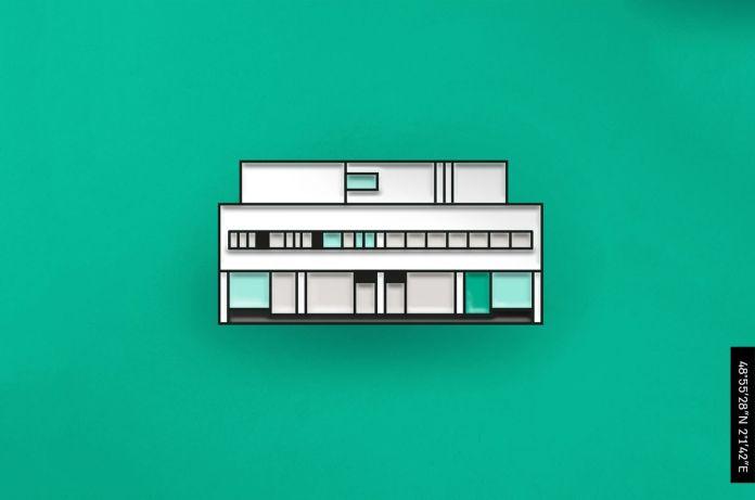 Эмалевый значок, изображающий белый модернистский дом с двумя этажами и структурой крыши. На первом уровне есть столбцы, а на втором-лента окон.