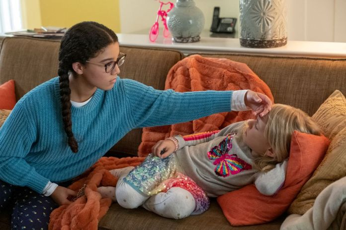 One of the babysitters worries over a sick kid in Netflix's The Baby-Sitters Club.