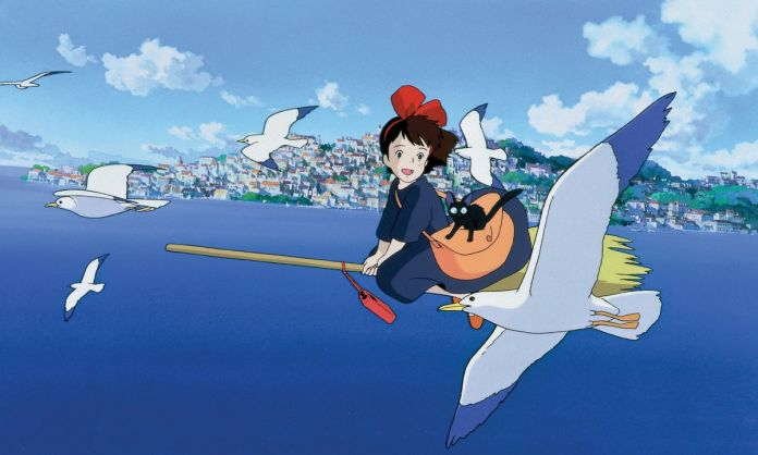 kiki flying by the sea