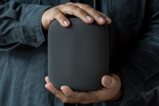 holding a homepod