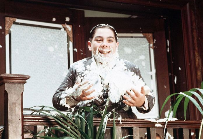 Fat Sam (John Cassisi) covered in whipped cream